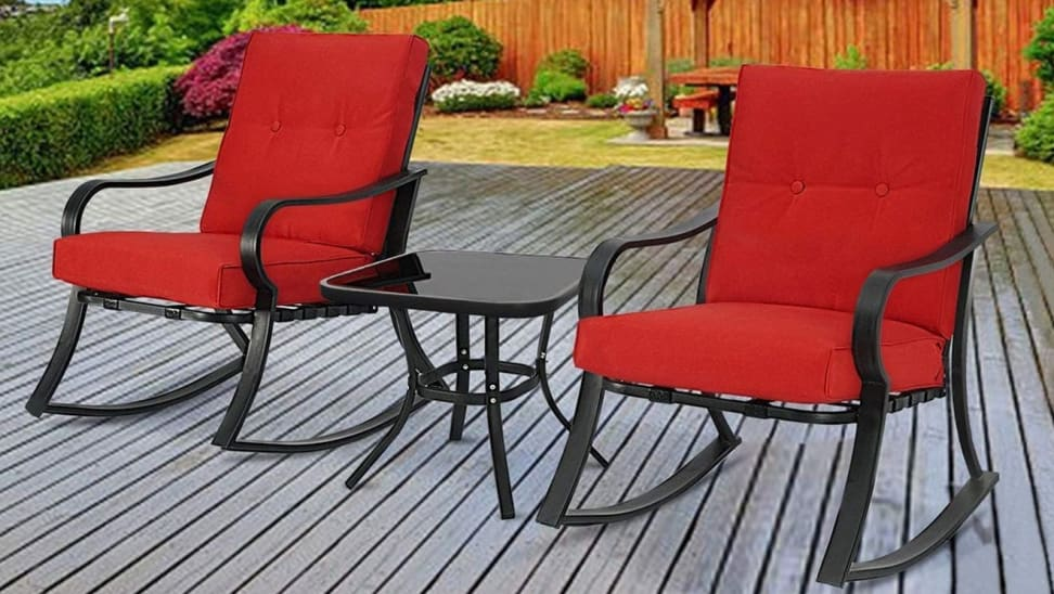Two red patio chairs outdoors.