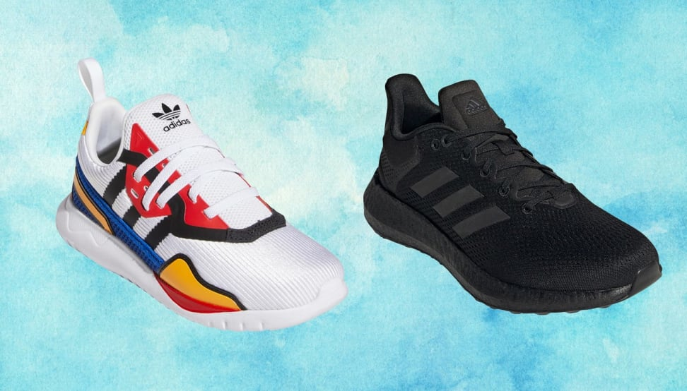 A multicolored and a black Adidas sneaker against a blue background.