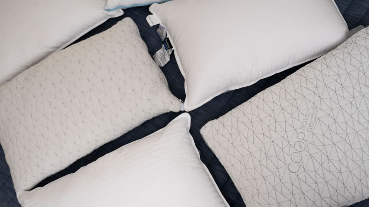 pillows spread out on a bed