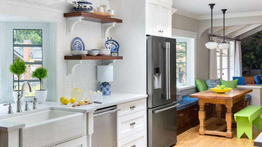 This kitchen, by Maria Killam, includes white subway tile and open shelving.