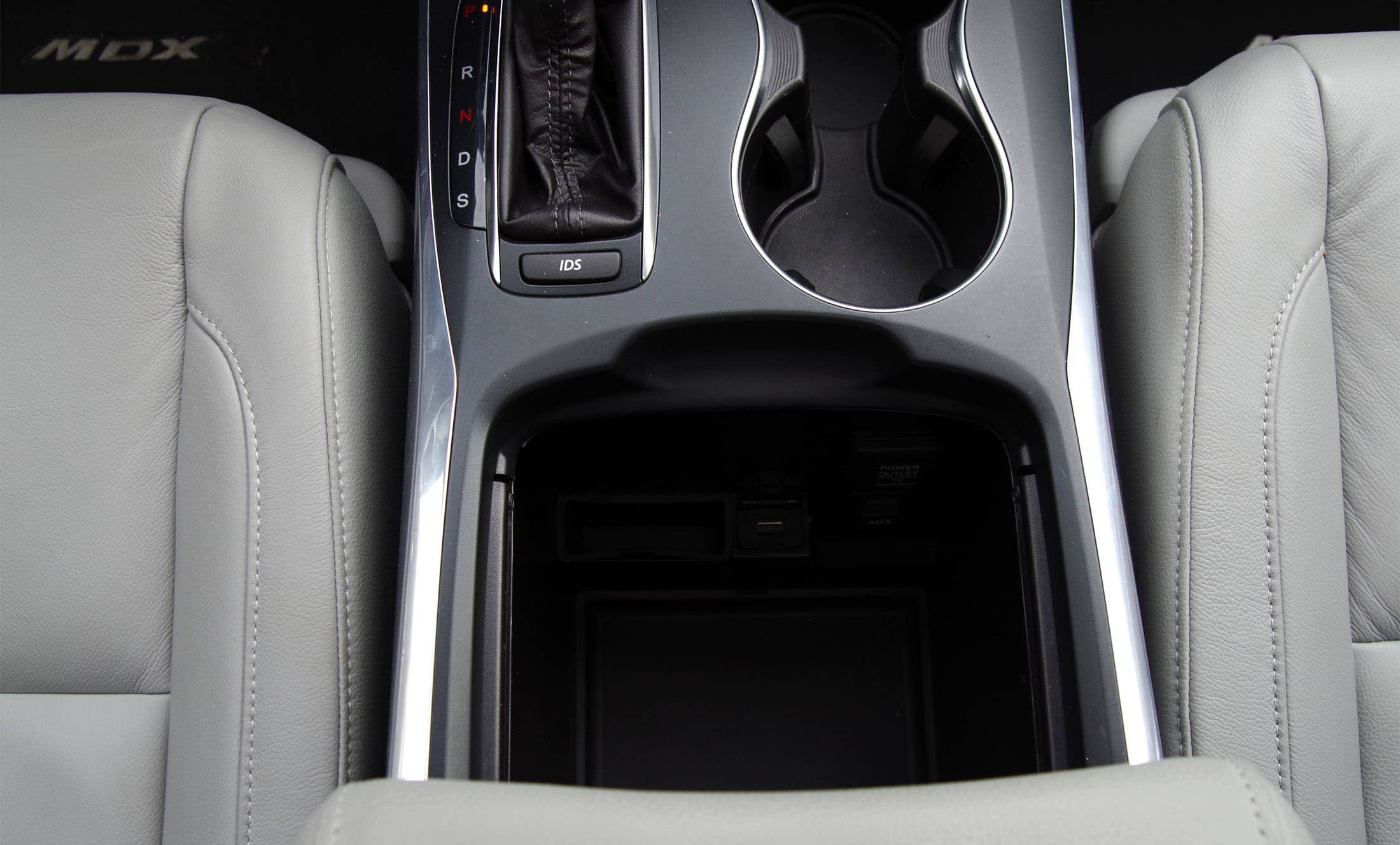 Store and charge your phone in the center console of the 2014 Acura MDX.