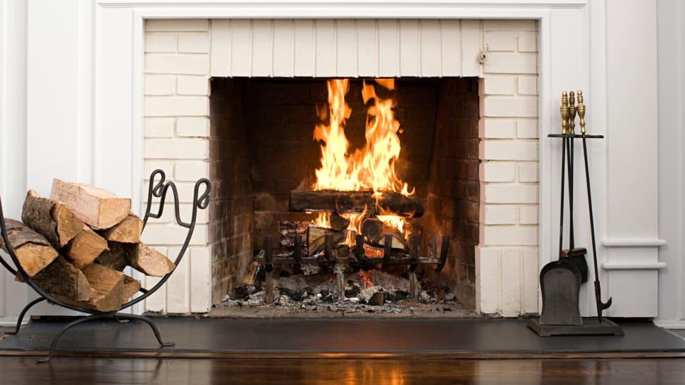 Wood logs burning inside of fireplace.
