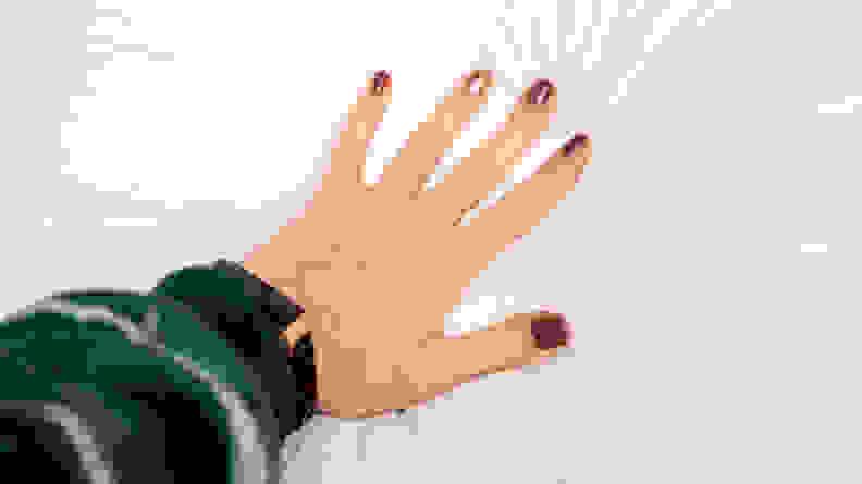 hand pressing into casper