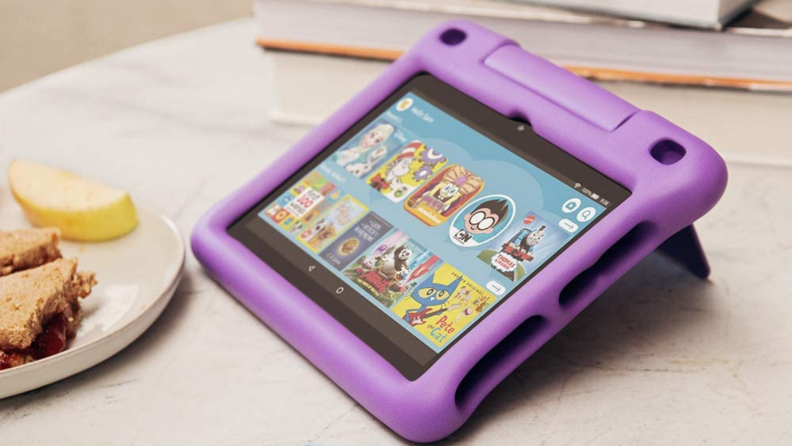 A pink Amazon tablet for kids on a breakfast table.
