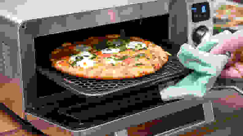 Sharp Superheated Steam Oven - Taking pizza out of the oven