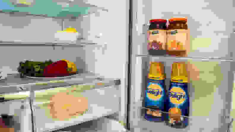 The right half of the Hisense HQD20058SV refrigerator's interior, with the right door open showing its internal storage compartments, stocked with items.