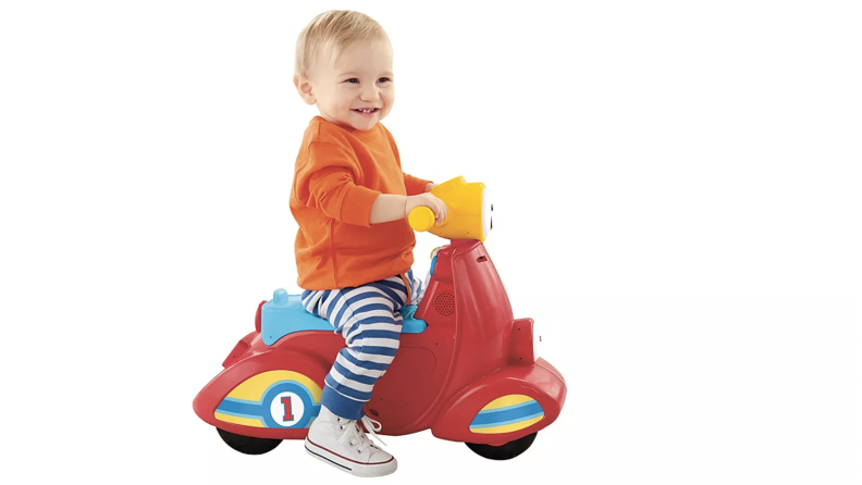 A baby on a toddler scooter