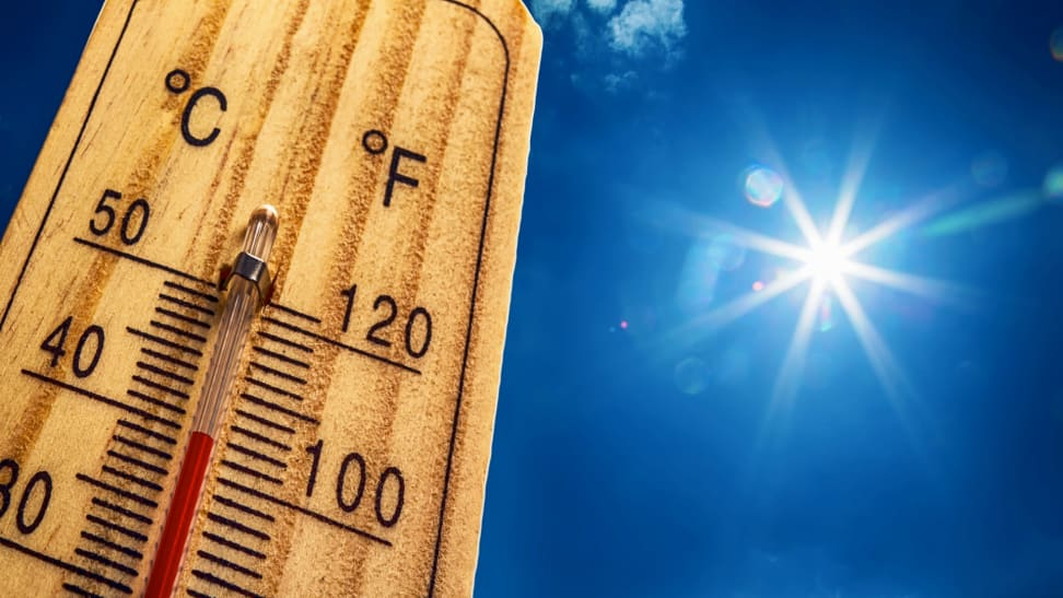 Thermometer rising above 100 degrees F with the bright sun in the background