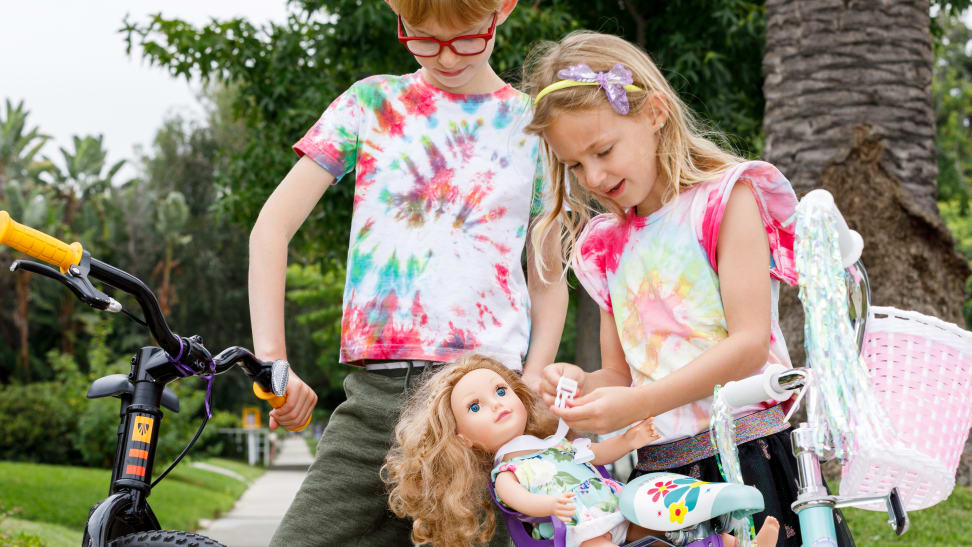 Two kids wearing tie-dye t-shirts