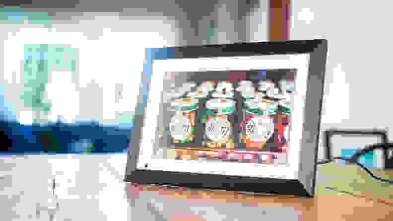 The Bsimb digital picture frame displays a colorful picture of wedding favors.
