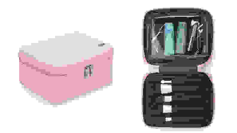 On the left: A pink Away cosmetic bag sits closed by its double zippers on a white background. On the right: The pink bag is opened to reveal a black interior with several makeup brushes in slots and toiletries in a pouch.