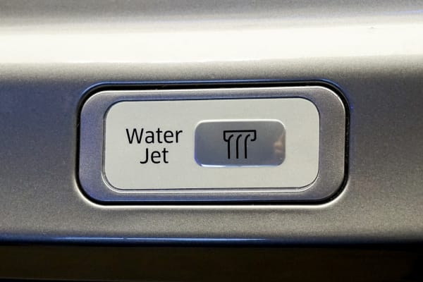 The button to active the jet is located on the front of the washer.