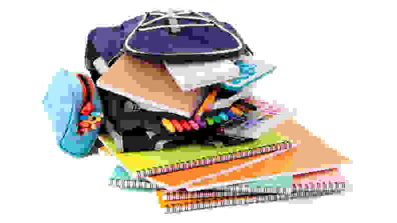 Backpack overfilled with school supplies