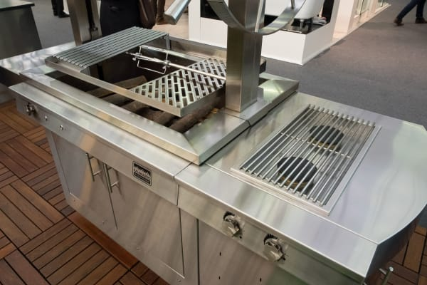 The gaucho grill also includes a pair of side gas burners that complement the grill.