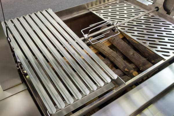 The gaucho grill includes the usual grilling surfaces, plus a unique sloped grate that channels juices to a catch pan (not pictured).