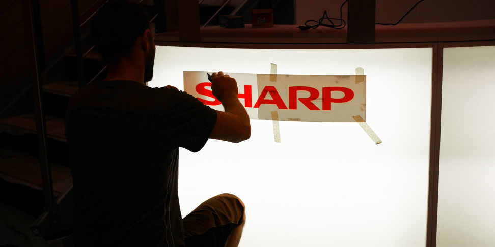 Sharp sets up its booth at IFA 2015