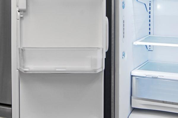 Left-hand door storage is slim to accommodate the GE Profile PFE28RSHSS's door-mounted icemaker.