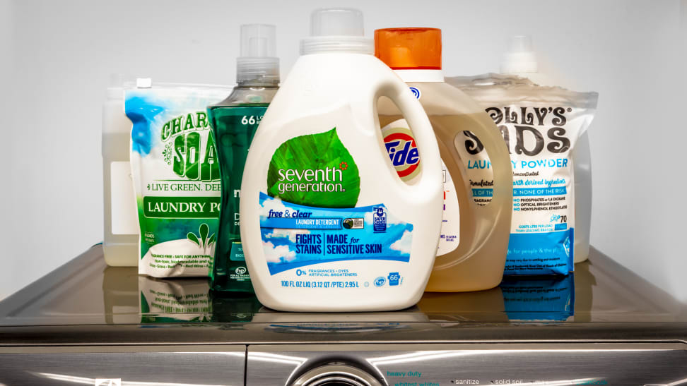 Seven eco-friendly laundry detergents in a v formation viewed from the front.