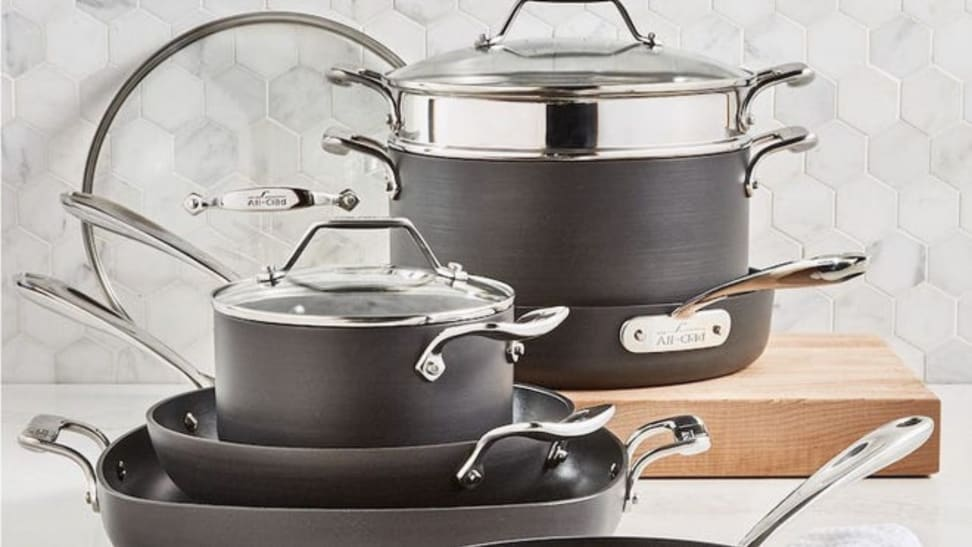 Set of slate gray All-Clad cookware set on countertop.