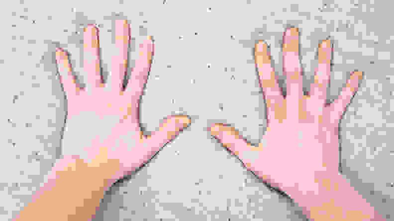 hands pressing into foam mattress