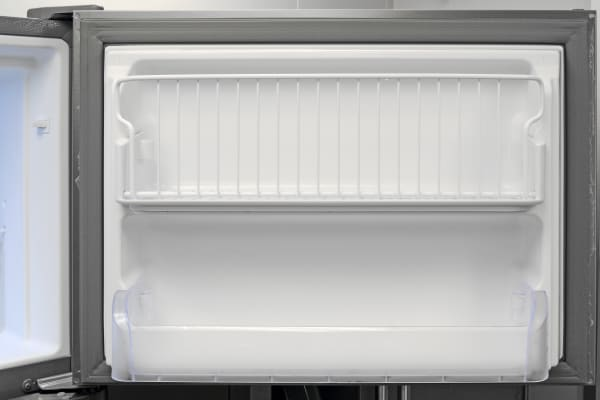 The top shelf on the Frigidaire Gallery FGHI2164QF's freezer door tilts forward, which could help prevent food from falling off an overcrowded shelf.