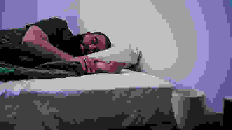 man sleeping on awara organic luxury hybrid mattress