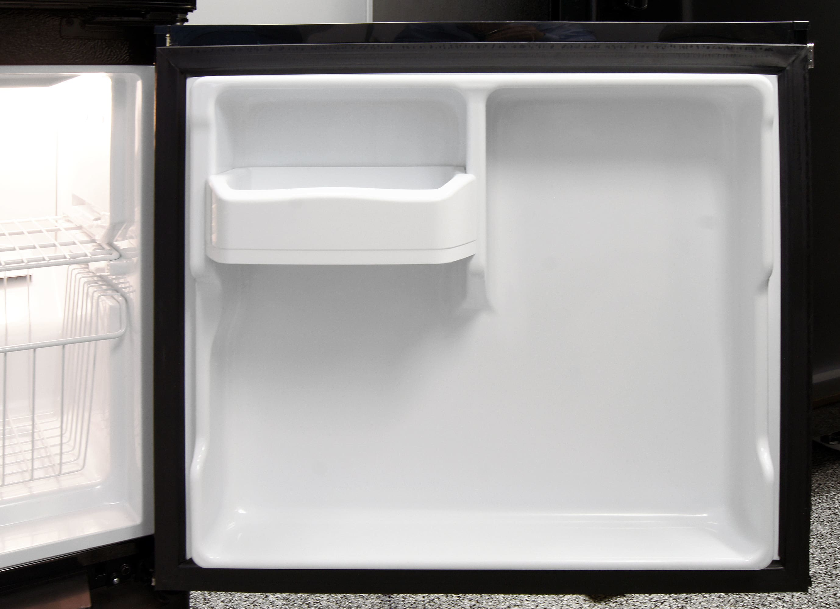 The GE Artistry ABE20EGEBS's freezer door gets just one lonely bucket shelf for supplemental storage.
