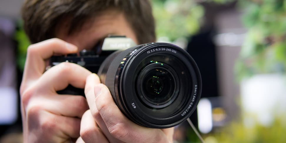 A photographer using a zoom lens