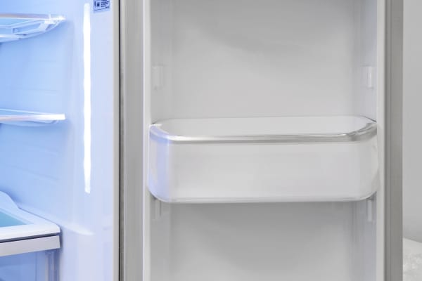 The LG LMXS30786S's right-hand door shelves are adjustable and can hold two gallon-sized jugs each.