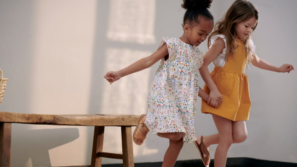 Two little girls playing hopscotch