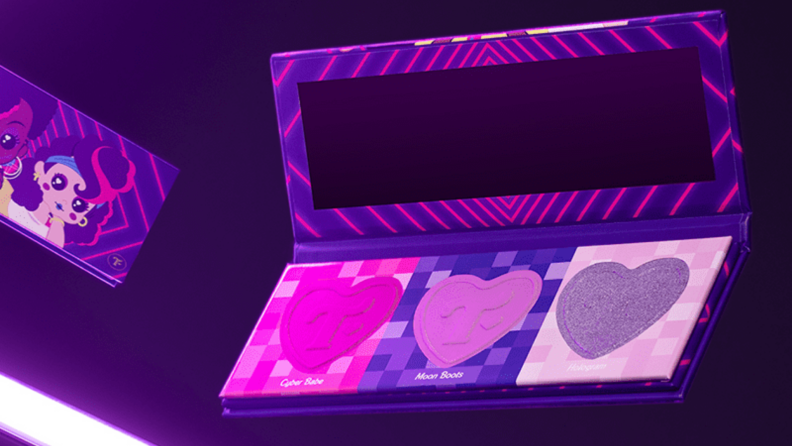 A Trixie Mattel Cosmetics makeup palette with shades of purple, pink, and fuschia.