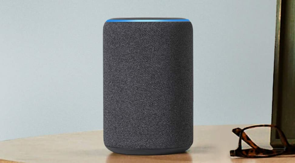 Amazon Echo Plus (second-generation) sitting on desk.