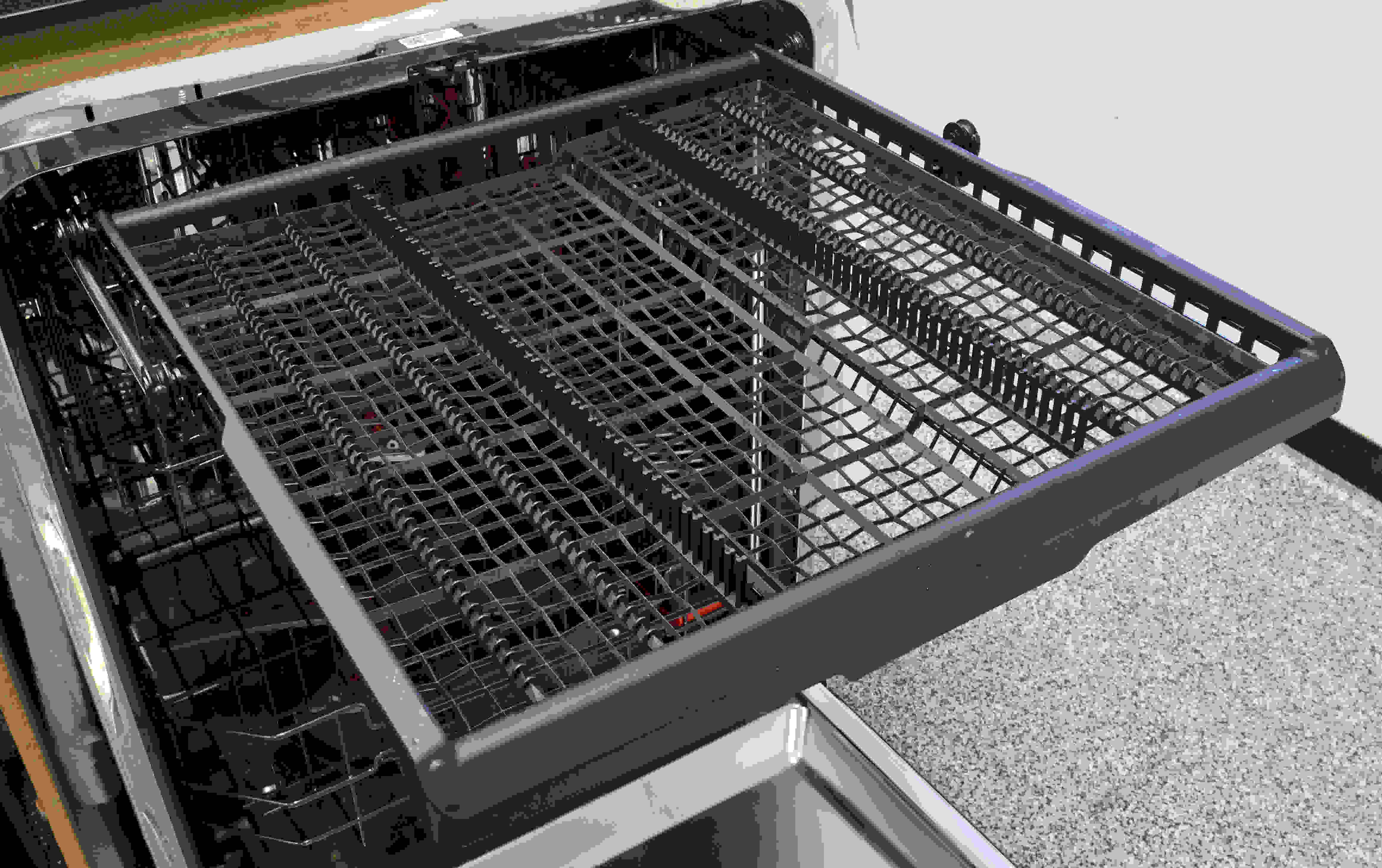 The GE Profile PDT855S's third rack is great for cutlery that can't fit in the lower basket, and can be easily removed for unloading.
