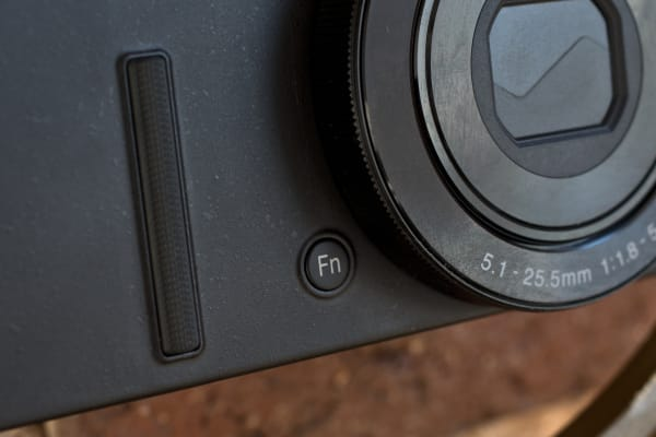 A photograph of the Nikon Coolpix P340's function button.