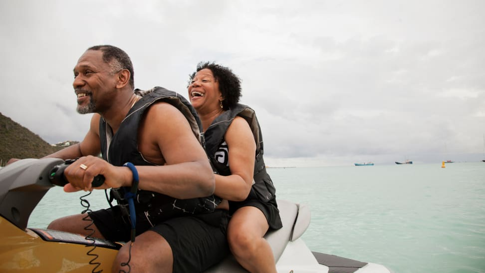 Retired couple riding together on a jet ski