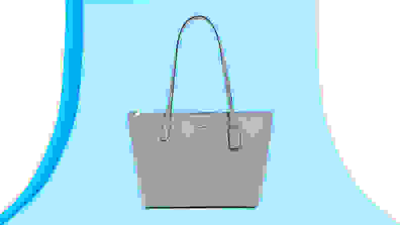 Pastel blue leather top handle purse from Coach.