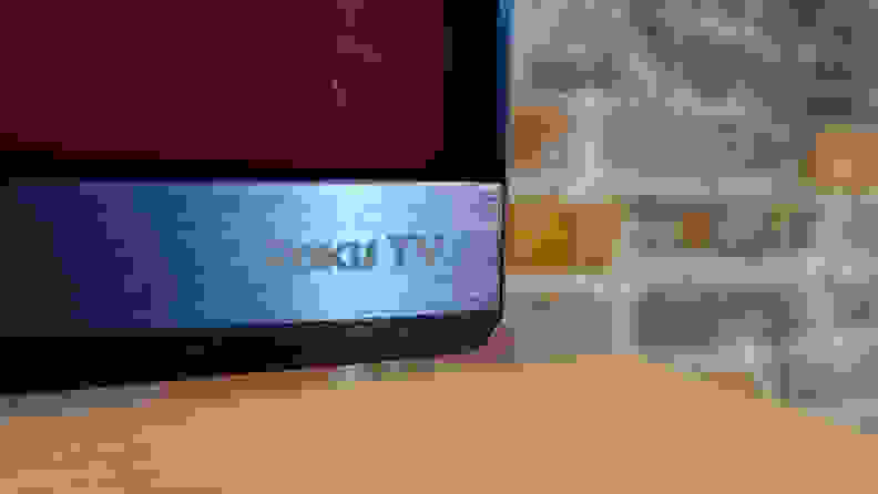 The Roku TV logo, as seen on the bottom of the TCL 6-Series panel