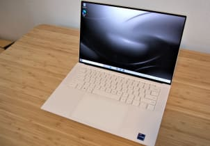 A Dell XPS 15 with OLED display on a desk.