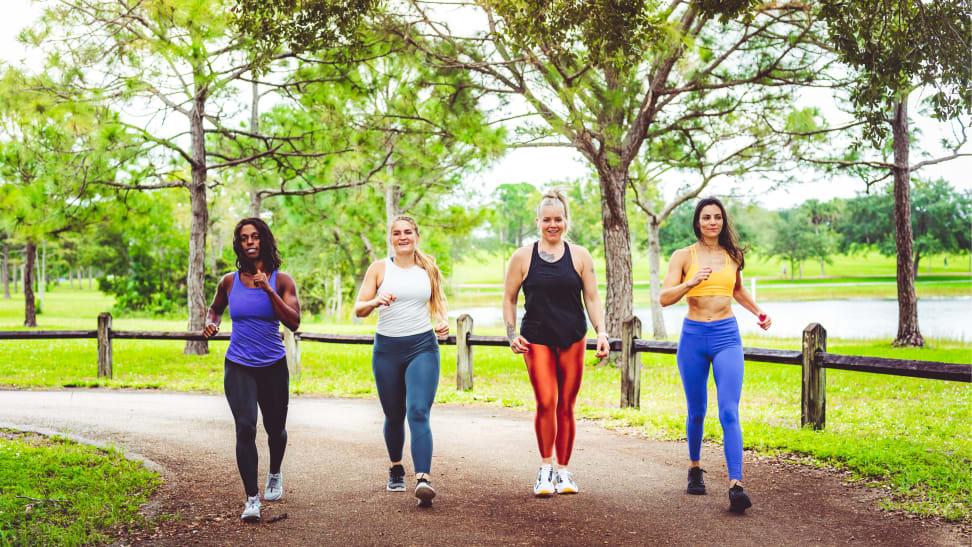 Four women walking in a park