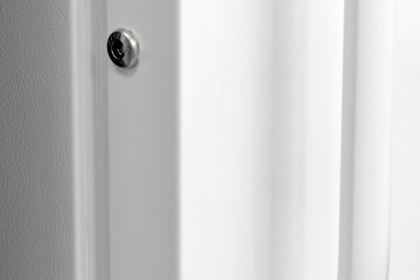 A plastic handle and door lock are common components of an upright freezer like the Frigidaire FFFH21F6QW.