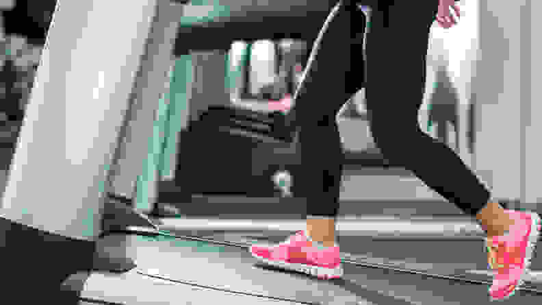 An image of a woman's legs as she walks on a treadmill.