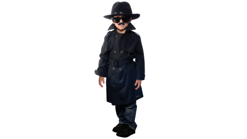 Young child wearing as a spy with black trench coat, hat and sunglasses.