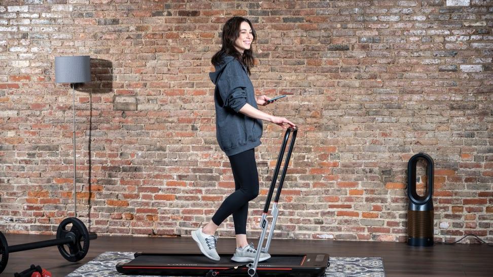 woman walking on treadly treadmill
