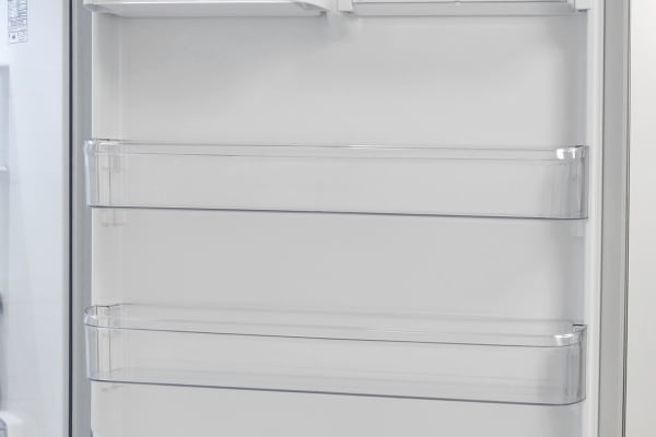 The LG LDCS24223S's door shelves are deep enough to hold gallon-sized jugs, but none of them are adjustable.