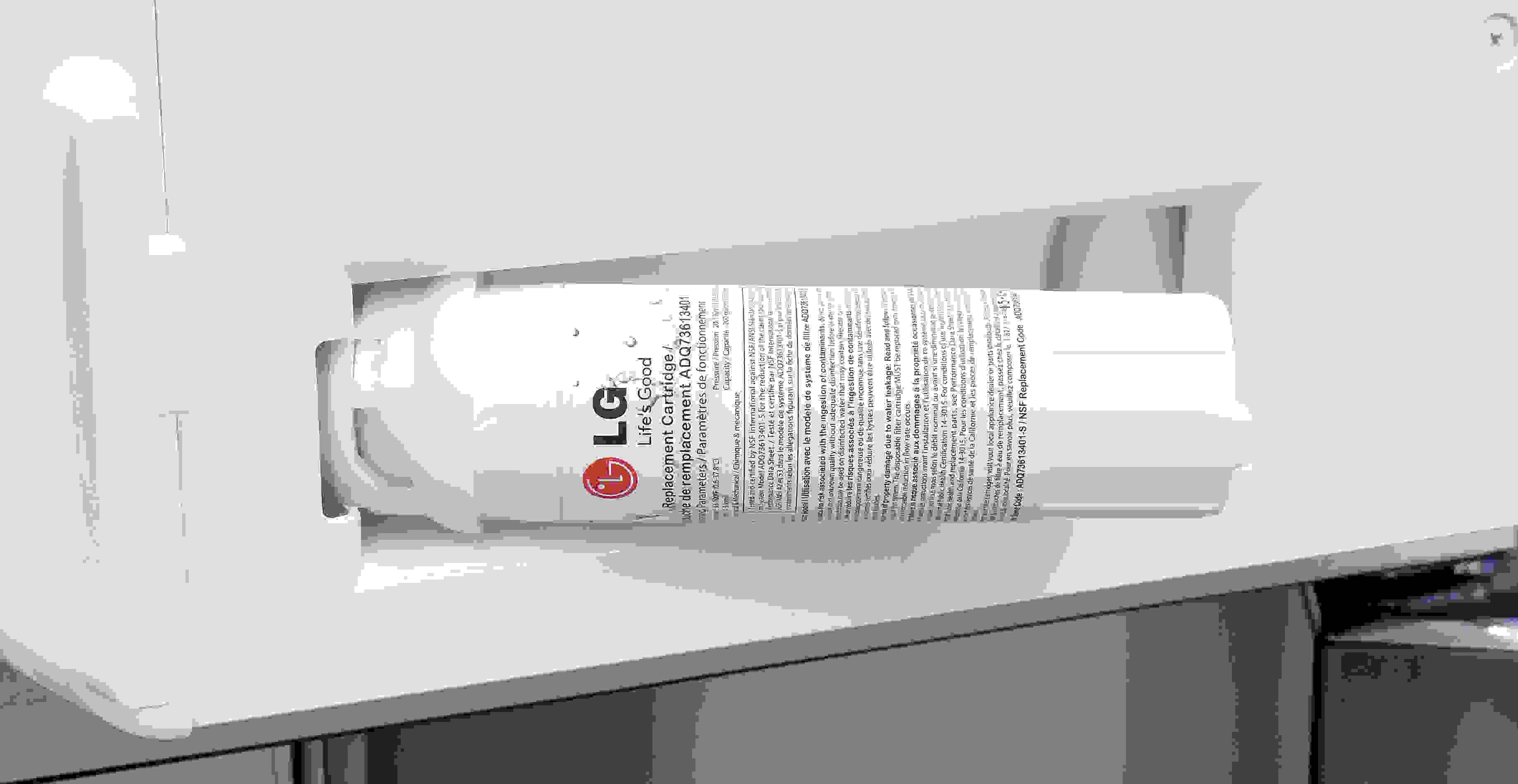 """The LG LPXS30866D's water filter is """"hidden"""" in a recessed nook behind the left fridge door's lowest shelf."""