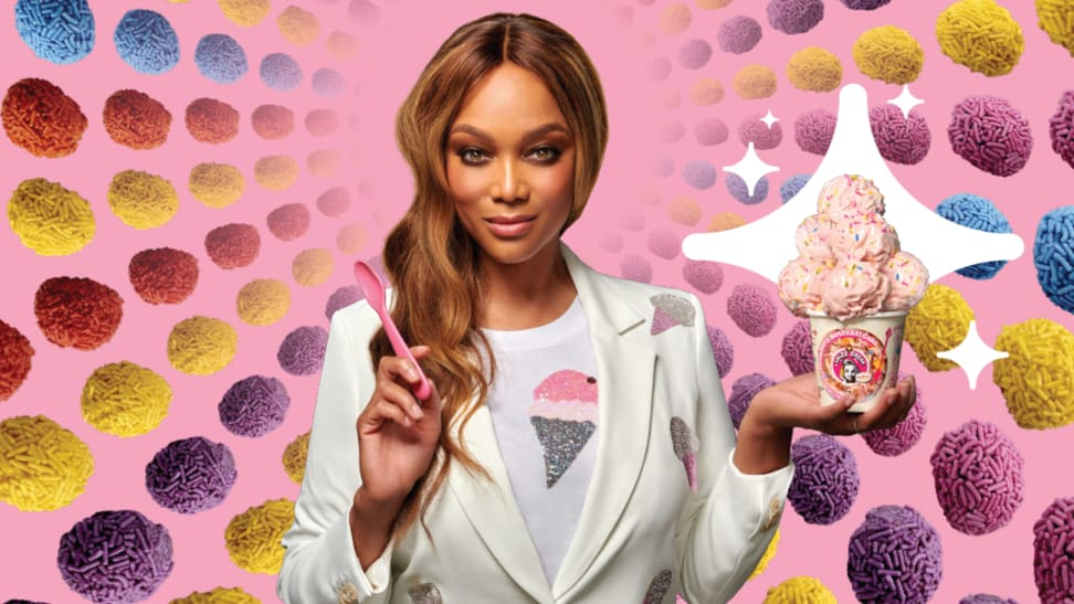 Supermodel Tyra Banks poses with scoops of pink ice cream surrounded by sprinkle-covered treats.