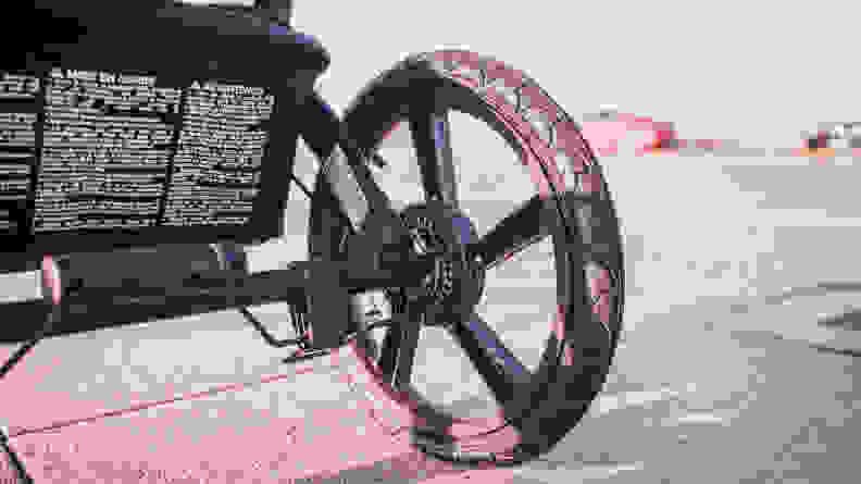 The wheel of a jogging stroller.