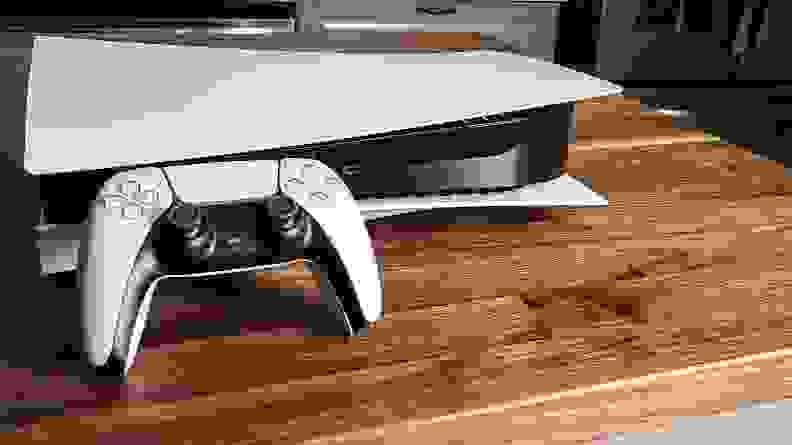 The playstation 5 and its controller on a table