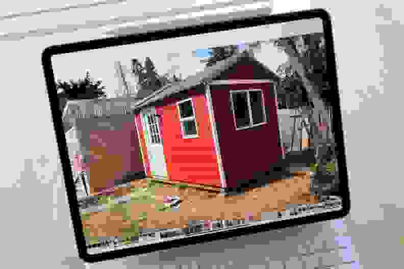 A small red shed displayed on a digital screen