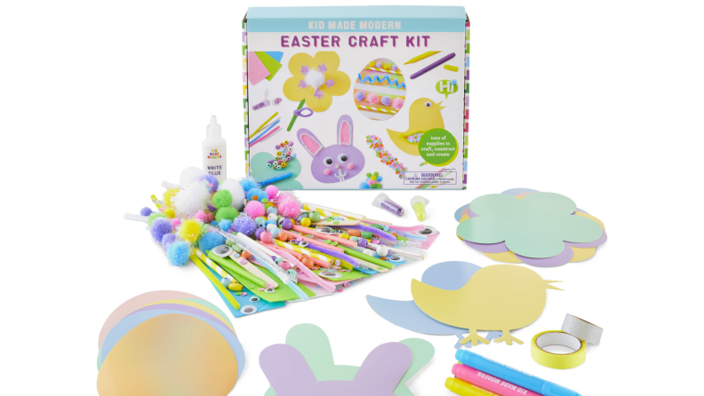 Easter craft kit with bunny, egg, and chickadee paper cutouts, pompoms, markers, and pipe cleaners.
